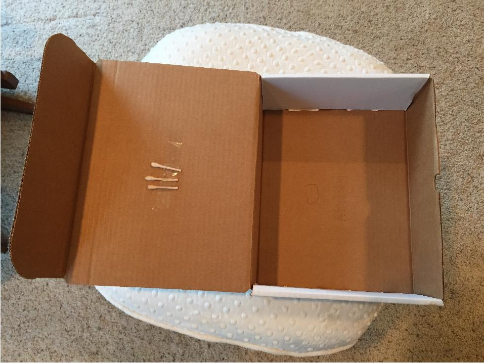 qtips taped in box